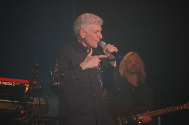 JOE PLASKO/TIMES NEWS Dennis DeYoung (with guitarist James Leahey in the background) performed the music of Styx at Penn's Peak Friday night.
