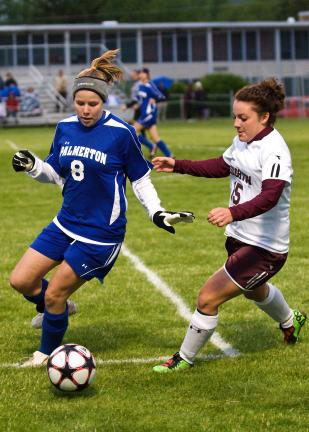 steve shinko/special to the times news Palmerton's Sarah Andrews (left) tries to maintain control of the ball as Lehighton's Katrina Reppert closes in to defend.