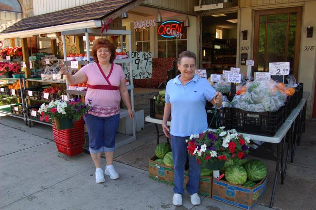 LINDA KOEHLER/TIMES NEWS Left, Lorraine Bognar, wife of Jim Bognar, and Diane Sestok, store clerk, invites people to visit C & C Food Outlet and Farm Fresh Produce for its wide selection of fresh fruit, vegetables, groceries and fresh flowers.