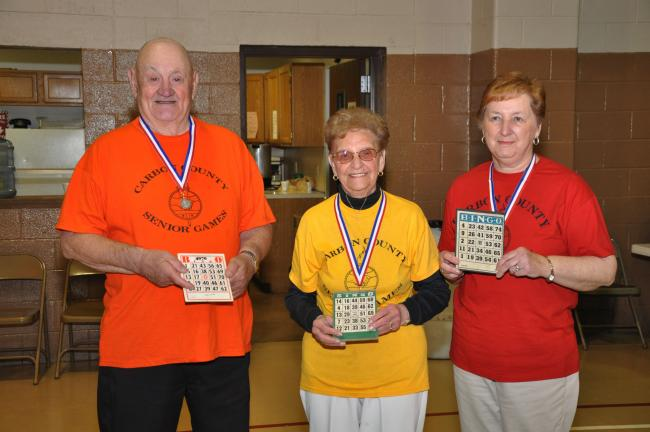 AMY ZUBEK/TIMES NEWS Senior Games Bingo winners show off their medals. They are, from left, Ed Leininger of Weatherly seniors, silver; Elaine Stockmal of Panther Valley seniors, gold; and Diann Stephens of Jim Thorpe seniors, bronze.