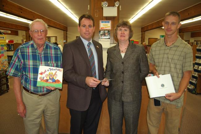 JOE PLASKO/TIMES NEWS The Tamaqua Lions Club donated $500 to the Tamaqua Public Library to defray the cost of the purchase of the book What a Treasure! through the Pa. One Book, Every Young Child program. $200 of the donation was earmarked for the…