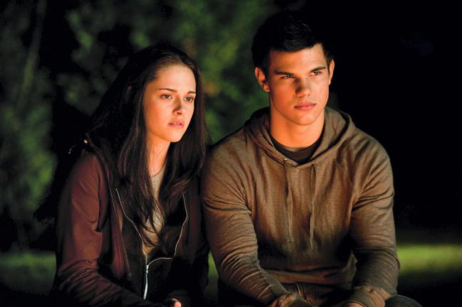 "AP PHOTO In this film publicity image released by Summit Entertainment, Kristen Stewart, starring as Isabella ""Bella"" Swan, left, and Taylor Lautner, starring as Jacob Black, are shown in a scene from ""The Twilight Saga: Eclipse."""