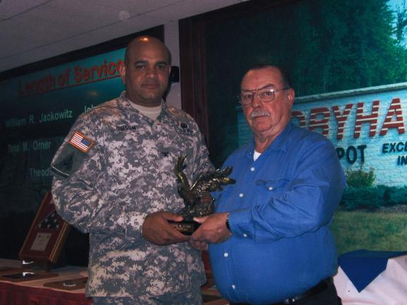 SPECIAL TO THE TIMES NEWS Theodore W. Hittner of Kresgeville, right, accepts a golden eagle from the Tobyhanna Army Depot's commanding officer, Col. Charles C. Gibson, for 50 years of outstanding service to his country.