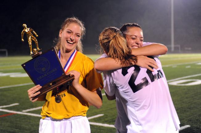 NANCY SCHOLZ/Special to THE TIMES NEWS Seniors Chelsea Ritter. Seneca Tucker and Emily Iobst celebrate after winning the Colonial League Girls Soccer Championship over Bangor by a 1-0 score.