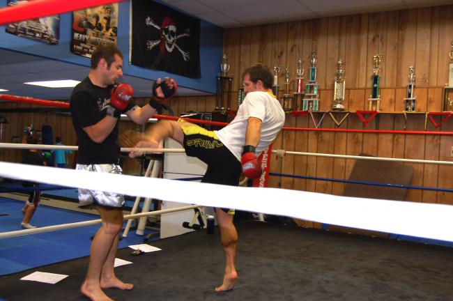 TERRY AHNER/TIMES NEWS Brian Hawk (against the ropes) spars with Joel Roberts (center) during a workout at Rat Pack Fighting Systems in Palmerton.