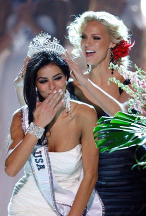 AP PHOTO Miss Michigan Rima Fakih, left, reacts as she is crowned Miss USA 2010 by Kristen Dalton, Miss USA 2009, Sunday in Las Vegas.