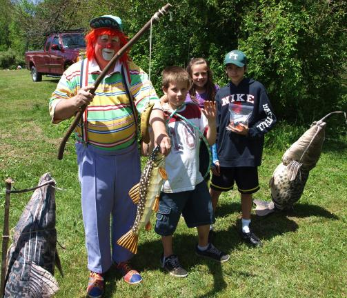 ANDREW LEIBENGUTH/SPECIAL TO THE TIMES NEWS During the Fourth Annual BWC Fishing Derby, face painting, duck race, balloons, fishing games, ball toss, crafts, and many other children's activities were available to the public. Pictured standing…