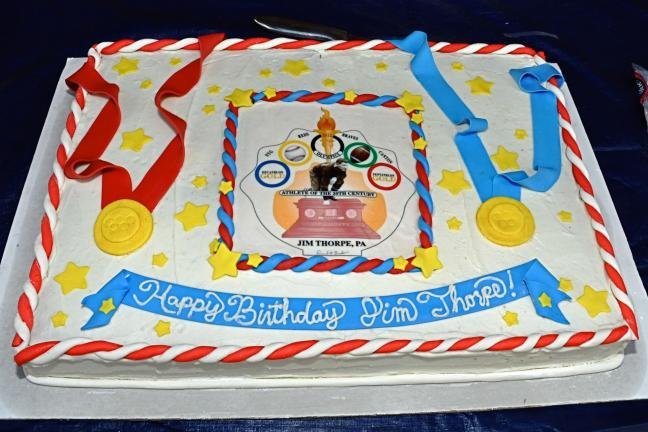 A large and colorful birthday cake, bearing the same new logo as the medals awarded for the Jim Thorpe Memorial Run, honors the town's namesake on the occasion of his 122nd birthday.