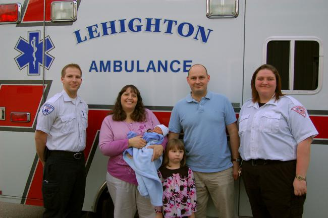 KAREN CIMMS/TIMES NEWS Members of the Walton family of Albrightsville, expressed their gratitude recently to paramedic Robert Bernabucci and EMT Kate McGinley, of Lehighton Ambulance Association. The pair delivered the Walton's son Andrew on the way…
