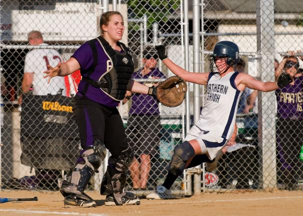 steve shinko/times news Northern Lehigh's Julie Wagaman scores as Palisades' catcher Marybeth Sadow waits for the ball during Thursday's Colonial League Championship game.