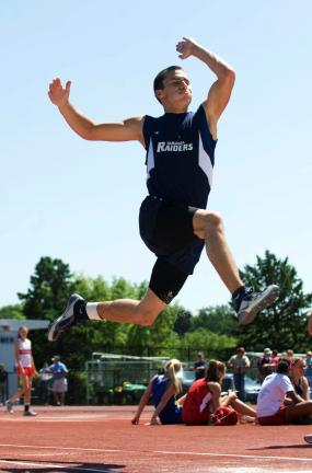 bob ford/times news Zach Lakitsky of Tamaqua leaps to a gold medal in the Class AA long jump.
