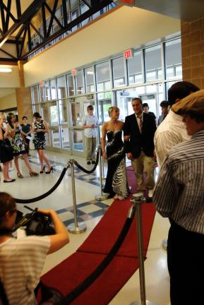 "NICOLE MATSAGO/SPECIAL TO THE TIMES NEWS Tamaqua Area High School tudents begin to enter the film festival event in their formal attire, first stopping on the ""red carpet"" to have their pictures taken by paparazzi."