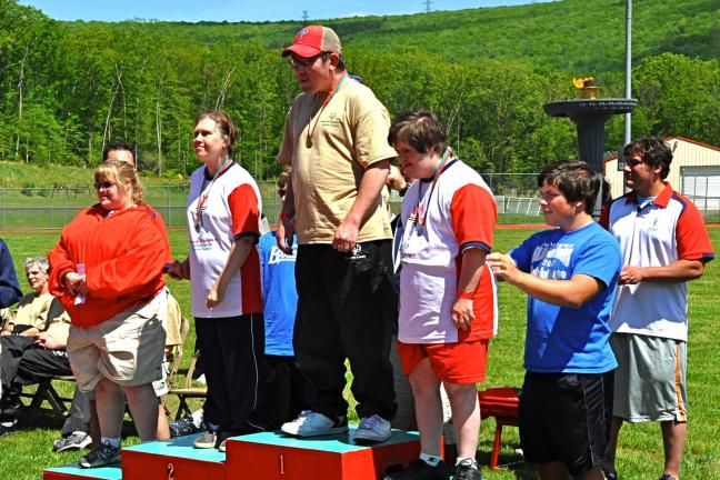 VICTOR IZZO/SPECIAL TO THE TIMES NEWS Special Olympians received their awards on a podium located in front of the Special Olympics Flame of Hope.