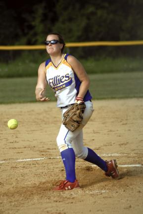Ron Gower/TIMES NEWS Marian's Kayla Knight delivers a pitch toward the plate Tuesday against Pius X.