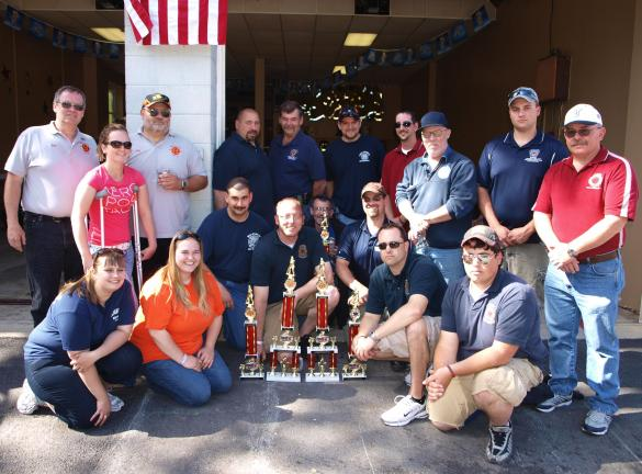 ANDREW LEIBENGUTH/SPECIAL TO THE TIMES NEWS Winners pose with their trophies following the Brockton fire truck parade.