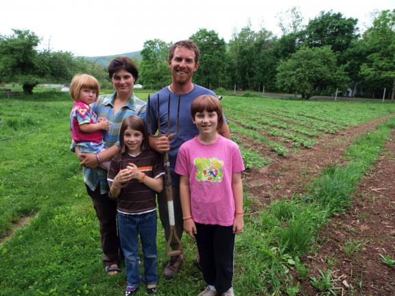 AL ZAGOFSKY/SPECIAL TO THE TIMES NEWS Sara and Kevin Ruch with their children (l to r) Phebe, 2, Zinnia, 9, and Amarynth, 10, at their 14 Acre Farm where an Open Farm will be held this weekend.