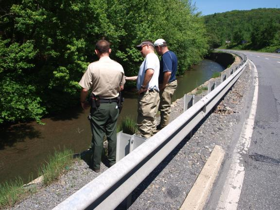 ANDREW LEIBENGUTH/SPECIAL TO THE TIMES NEWS Pictured investigating hundreds of dead floating fish in the Little Schuylkill River stretching from the Tamaqua Borough to parts of South Tamaqua are officials from the Pennsylvania Department of…