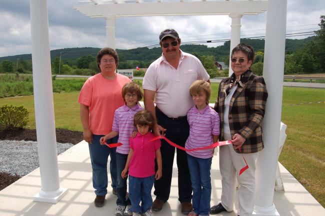 JOE PLASKO/TIMES NEWS Clear View Acres held a ribbon cutting ceremony on Saturday, May 21. Participating were, front from left, Meghan, Makenzie and Mikayla Moyer, children of the owners. Back row, Karen and Larry Moyer, owners, and Linda Yulanavage…