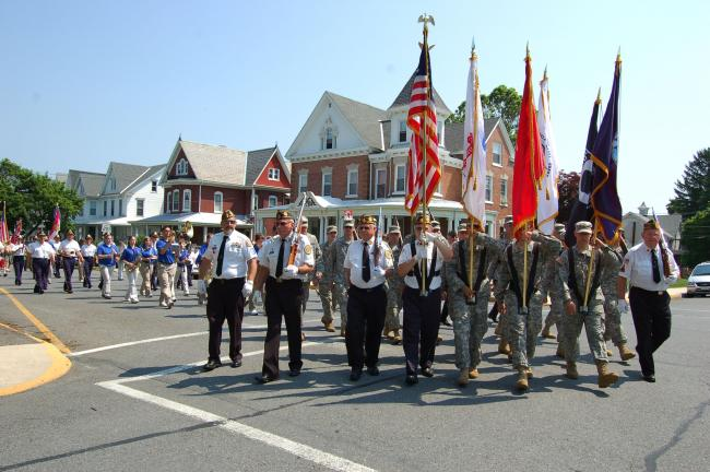 Gail Maholick/TIMES NEWS The United Veterans Organization color guard, which includes several active duty soldiers from the National Guard lead the Lehighton Memorial Day Parade to the Lehighton Cemetery.