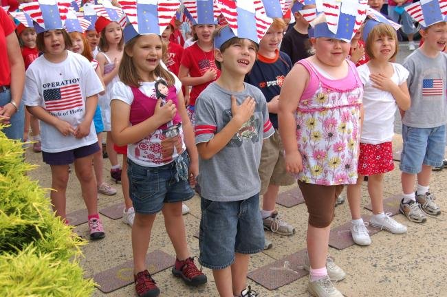 "Gail Maholick/TIMES NEWS Kindergarten students at Franklin Elementary School sing, ""Our Flag"" during Memorial Day services held at the school."