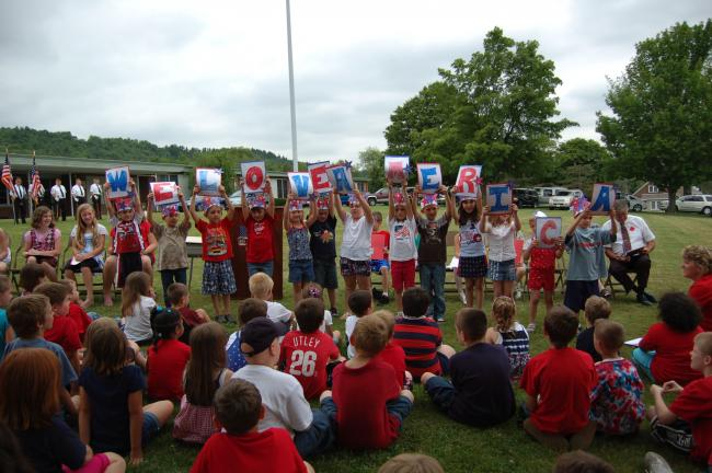 "Gail Maholick/TIMES NEWS Students at East Penn Elementary School proudly hold up ""We Love America"" as they read the poem, ""The Love We Love."""