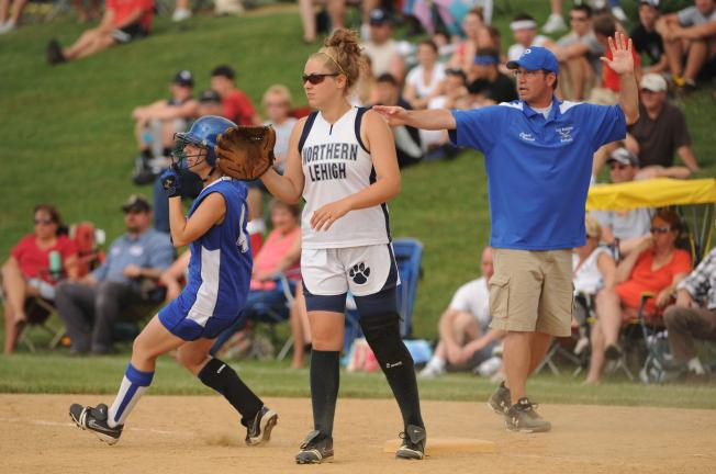 nancy scholz/Special to THE TIMES NEWS Palmerton's Michelle Rickert rounds first base after hitting a single in the fifth inning as Northern Lehigh first baseman Sarah Frantz waits for tje throw.