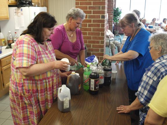 Andrew Leibenguth/times news Patricia Freeh-Stefanek, ABC Building Manager, (second from left) and high-rise residents provide cold refreshments to other residents during the a tenant meeting held Friday afternoon.