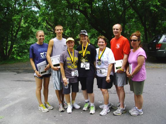 CHRIS MORAN/SPECIAL TO THE TIMES NEWS Pictured left to right: 1st Place Overall Runners Samantha Snukis, St. Clair 21:31, Kyle Picht, Nesquehoning 19:20; Cancer Survivors Susie Bortnick, Coaldale 56:00, Jennifer Sloot, Sugarloaf 28:56, and Linda…