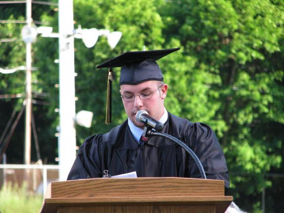 LIZ PINKEY/SPECIAL TO THE TIMES NEWS Class of 2010 president Jason Harrison welcomes families and friends to the 46th Commencement Ceremony.