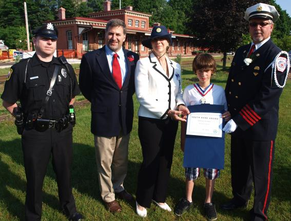 ANDREW LEIBENGUTH/SPECIAL TO THE TIMES NEWS Presenting the Youth Hero Award to Casey Leone, second from right are, from left, Tamaqua Police Officer Michael Hobbs, Tamaqua Mayor Christian Morrison, Eastern Pennsylvania Veterans Affairs…