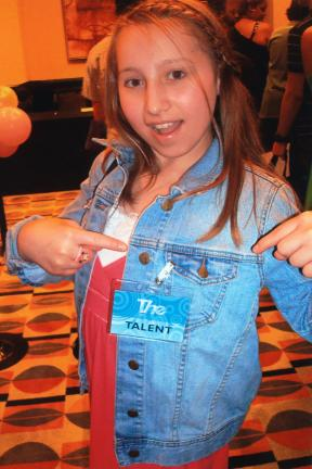 SPECIAL TO THE TIMES NEWS Emel Rasim of Palmerton was one of 25 chosen out of a 1,000 young people who auditioned at the The Talent event in Philadlephia to continue the next phase in Florida. Here she is showing off her official The ID as she…