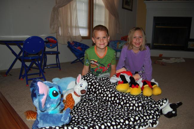 Gail Maholick/TIMES NEWS Brandon Hall and his sister, Emma, with Brandon's favorite souvenir from Sea World - a stuffed stingray.