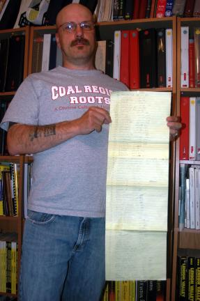 DONALD R. SERFASS/TIMES NEWS Using the Magna Carta as a resource, genealogist Bob Kunkel has traced his family lineage back to 1379.