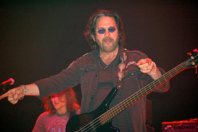 JOE PLASKO/TIMES NEWS Kip Winger points to the Penn's Peak crowd during Winger's performance Friday night.