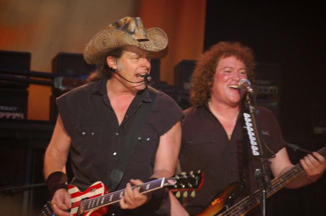 JOE PLASKO/TIMES NEWS Ted Nugent and bassist Greg Smith (right) jam on stage at Penn's Peak Thursday night.