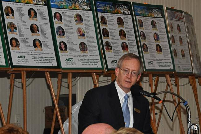 "VICTOR IZZO/SPECIAL TO THE TIMES NEWS With the photos and biographies of past Community Heroes in the background, MCT President and CEO Patrick H. Reilly speaks to the more than 240 guests attending the 2010 ""MCT Community Heroes Award Banquet""…"