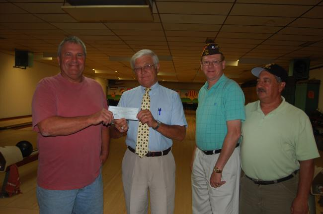 TERRY AHNER/TIMES NEWS Steve Vasko (left), president of the Palmerton Hungarian Club, presents a check to Richard Nothstein (second from left) as a contribution toward the eventual veteran's memorial that will be erected in the borough park to honor…
