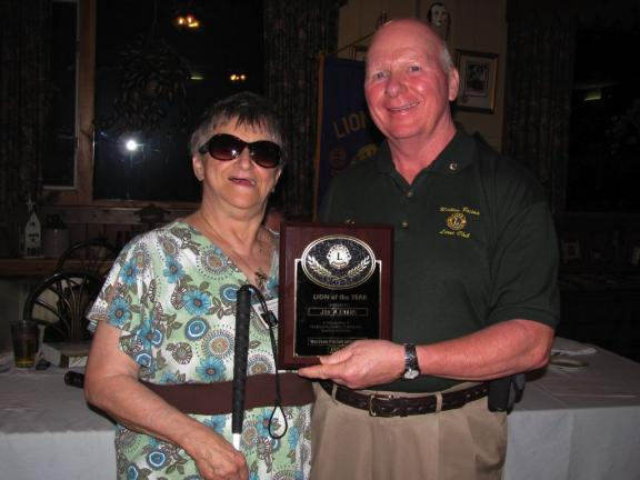 "SPECIAL TO THE TIMES NEWS Western Pocono Lions Club President Helen Koshensky, left, chose Lion Jon W. Evans as ""Lion of the Year."" He will be the club's new secretary for the coming program year, which begins July 1."