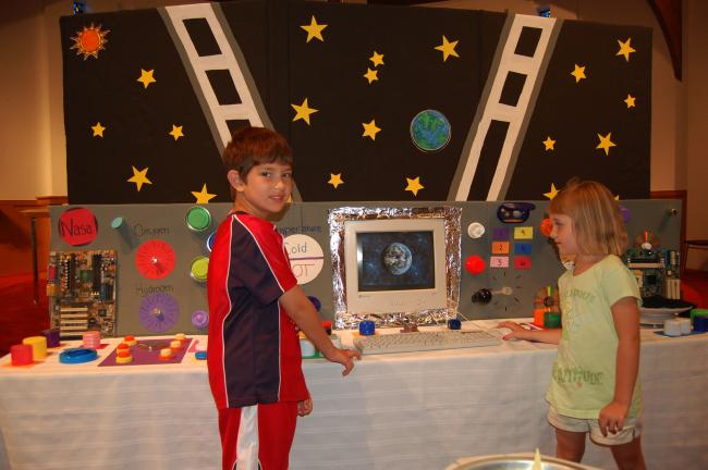 Gail Maholick/TIMES NEWS Among the children enjoying the outer space experience at Trinity Lutheran Church Vacation Bible School were, from left, Logan Kester and Alyssa Stubits.