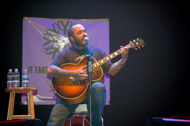 Aaron Lewis performs Staind hits on acoustic guitar at Penn's Peak Thursday night. JOE PLASKO TIMES NEWS