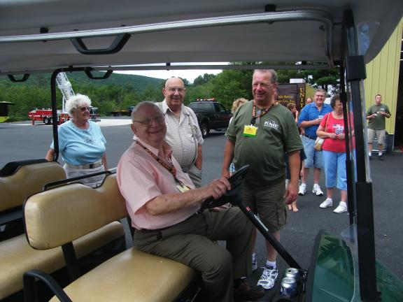 CAROL ZICKLER/SPECIAL TO THE TIMES NEWS John Kovatch Jr., the founder of Kovatch Industry, (sitting in golf cart) gives tours of the plants. Looking on is John Kovatch III, president and CEO, right. Departing from the tour are Mr. and Mrs. Leroy…