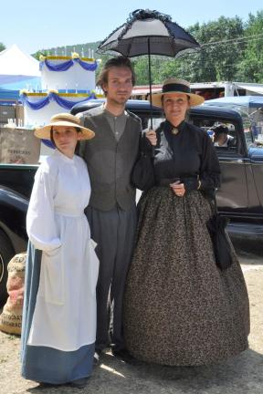Dressed in period attire, Eckley Players, left to right, Moria Petchel, Vincent Kundrik, and Barbara Kundrik were among the participants who strolled about the grounds and put on skits about the lives of coal miners and their families.