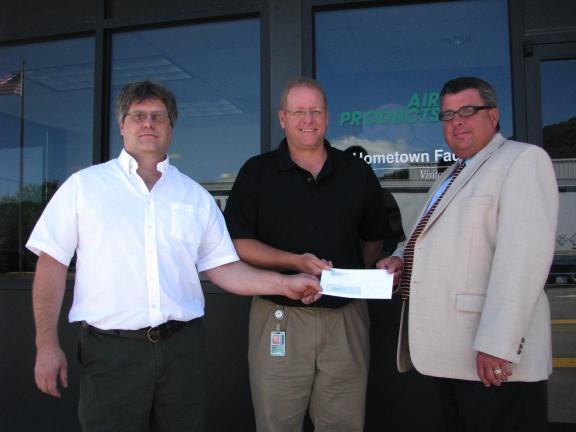 Rush Township supervisors Robert Leibensperger (left) and Steve Simchak (right) receive a $5,000 donation from Air Products, Hometown site manager Karl Nolte. The funds will be put towards improvements at Ryan Park. SPECIAL TO THE TIMES NEWS