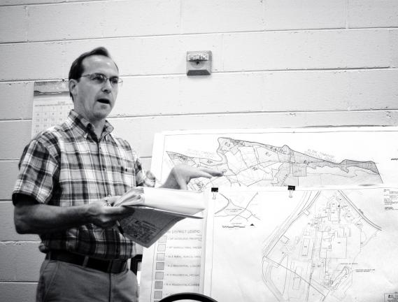 DONALD R. SERFASS/TIMES NEWS George Stianche of Air Products and Chemicals uses a chart to show the position of a building which would be used to transfer and store silane gas. Stianche explained the process at Tuesday's Rush Township zoning hearing…