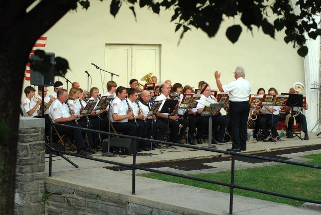 Ron Gower/TIMES NEWS The Lehighton Band, directed by Paul R. Smith, performs recently in the Lehighton Park Amphitheater. On Saturday, the band will be putting on a free concert at 7 p.m. at Mauch Chunk Lake Park.