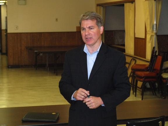 ANDREW LEIBENGUTH/SPECIAL TO THE TIMES NEWS Sen. Dave Argall (R-29) talks to many local community leaders during his hosted Cost-Saving Innovations Program held Thursday evening at the Tamaqua Community Center in Tamaqua.