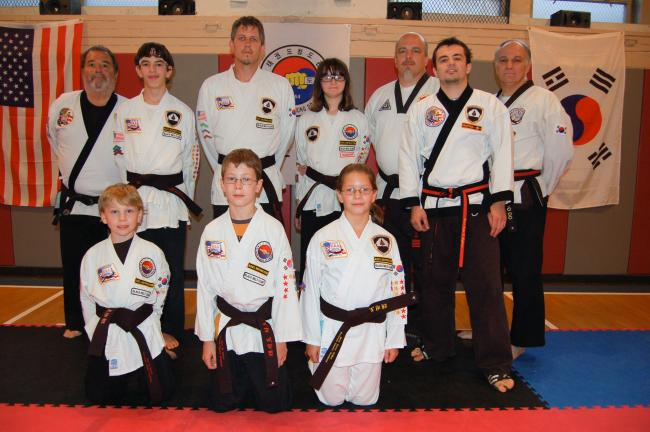 Mountain Karate Academy, Lehighton, recently tested six students for black belt status. Among the awardees are, from left, kneeling in front, Alex Hauck, Jerry Hauck and Mary Grace Collins; and back row, Instructor Rich Maglionico, Kyle Collins, Tim…
