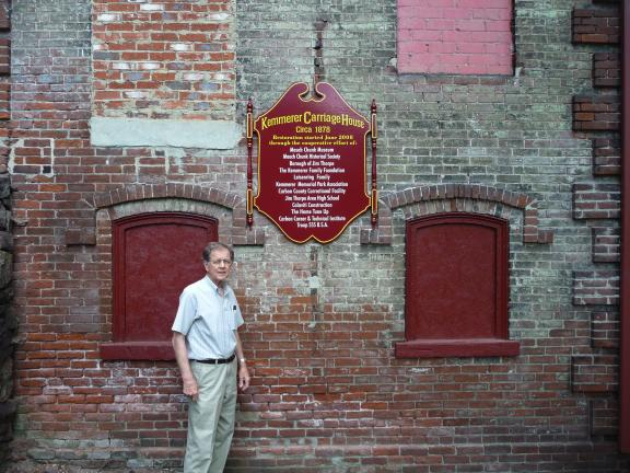 MICHAEL NEWTON/SPECIAL TO THE TIMES NEWS John Drury stands in front of a restored wall of the carriage house.