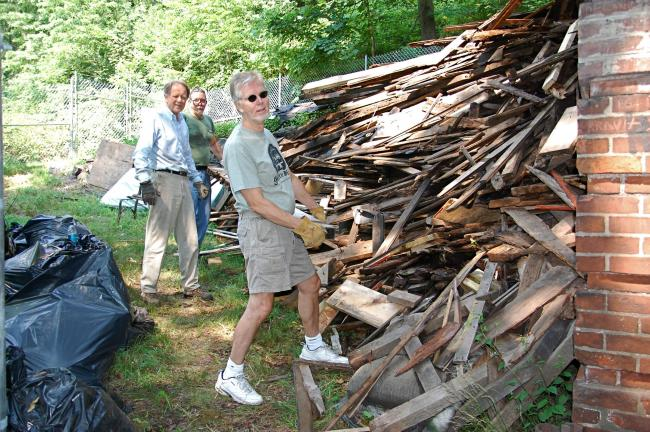 "TIMES NEWS FILE PHOTO John Drury, Jack Sterling and Bill Allison, of the Mauch Chunk Historical Society and the the Mauch Chunk Museum put in a day of backbreaking ""sweat equity"" as they worked to clear away the rubble from years of neglect of the…"