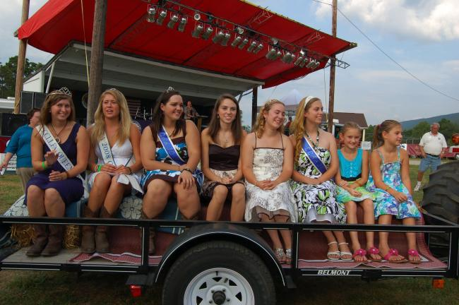 Gail Maholick/TIMES NEWS Former fair queens and 2010 fair queen candidates arrive on a hay wagon for the opening ceremony. From left are, Christiana Graver, 2007 Fair Queen; Emily Mitchell, 2008 Fair Queen; Tiffany Erney, 2010 second runner up;…